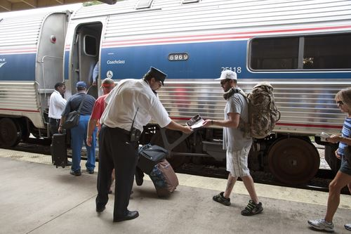 People boarding an Amtrak train